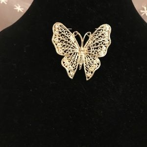 Vintage gold tone and rhinestone butterfly brooch